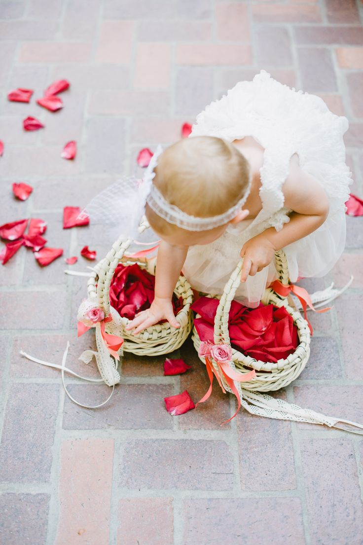 Adorable Flower Girl pickin' up the petals! -Photography: SargeantCreative.com -