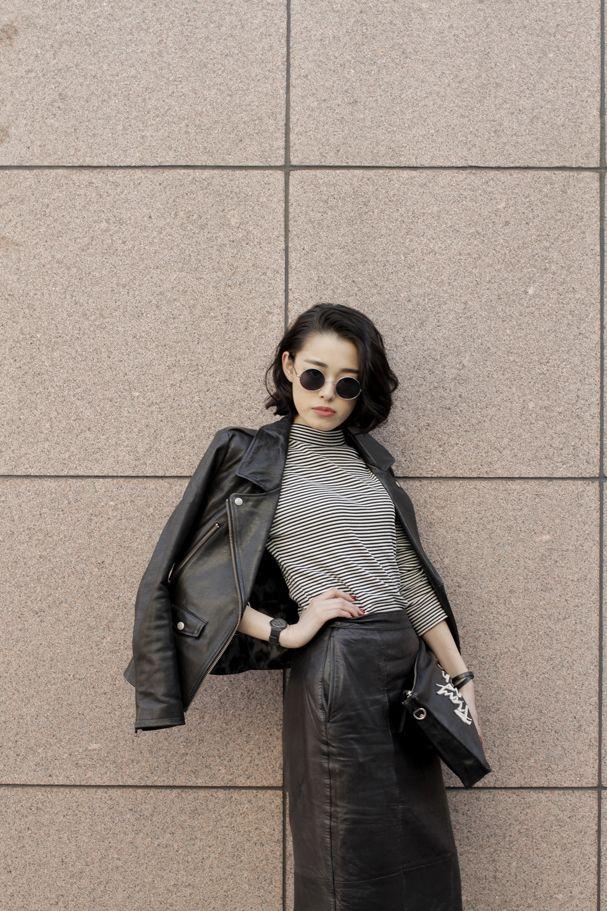 Black leather jacket, black midi length leather skirt, striped top