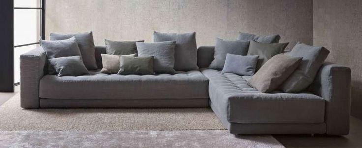 Divani angolari per la casa - Divano grigio con cuscini