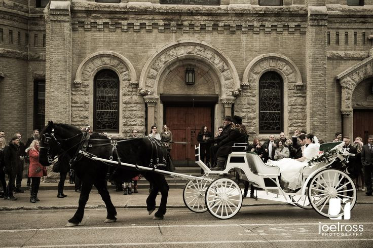 Leaving the wedding ceremony in their horse and carriage. http://www.joelross.com