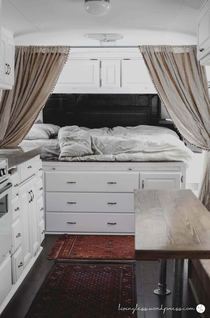 34' 1988 Avion Travel Trailer Renovation Master Bed / White Paint with Dark Hardwoods / Vintage Decor / Vintage Rugs / White Cabinets / Vintage Curtains / Boho Decor / Industrial Table / Industrial Decor / Tiny Living / Airstream Renovation / Vintage Travel Trailer Renovation / Travel Trailer Remodel / Minimalism
