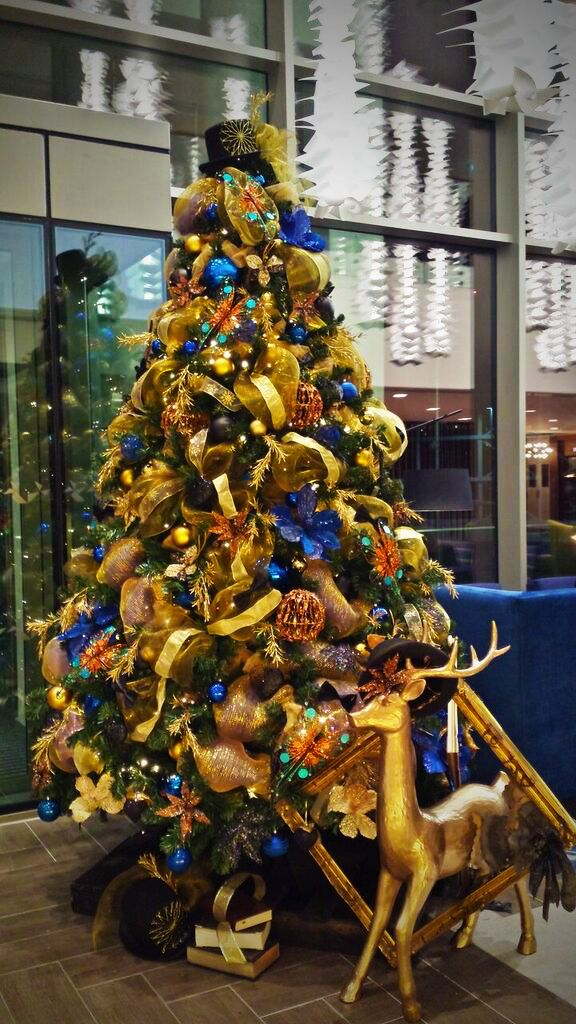 Gold, Bronze and blue Christmas tree for hire. Our gold, bronze and blue Christmas trees can be hired in the UK.