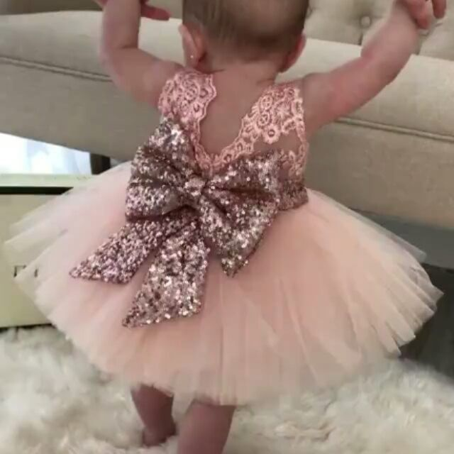 Look at this wee one dazzle in @ittybittytoes rose gold! This dress is just way too precious with its sparkle and tulle!
