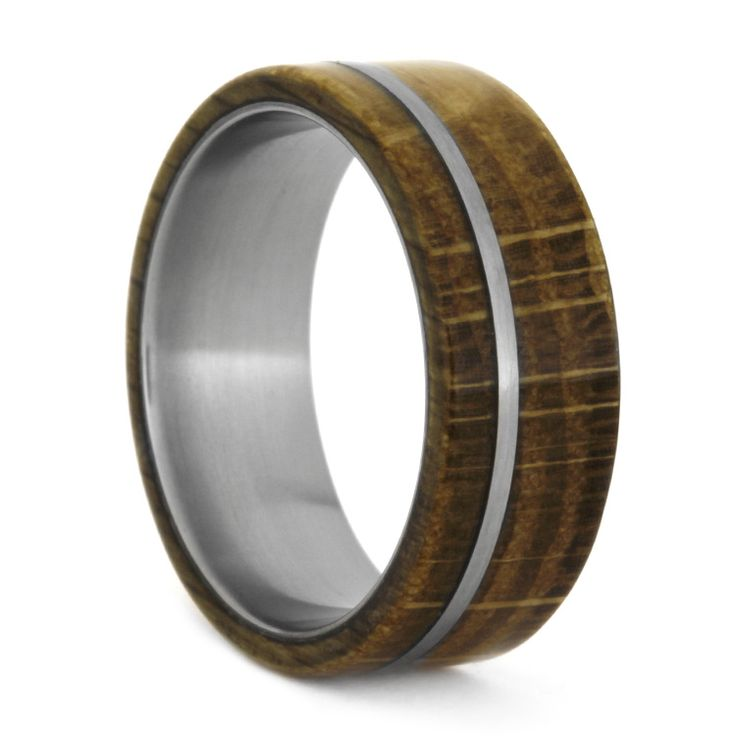 Real Jack Daniels barrel oak surrounds this ring. Warm and iridescent in color, the matte finish is completed with the addition of a thin stripe of...