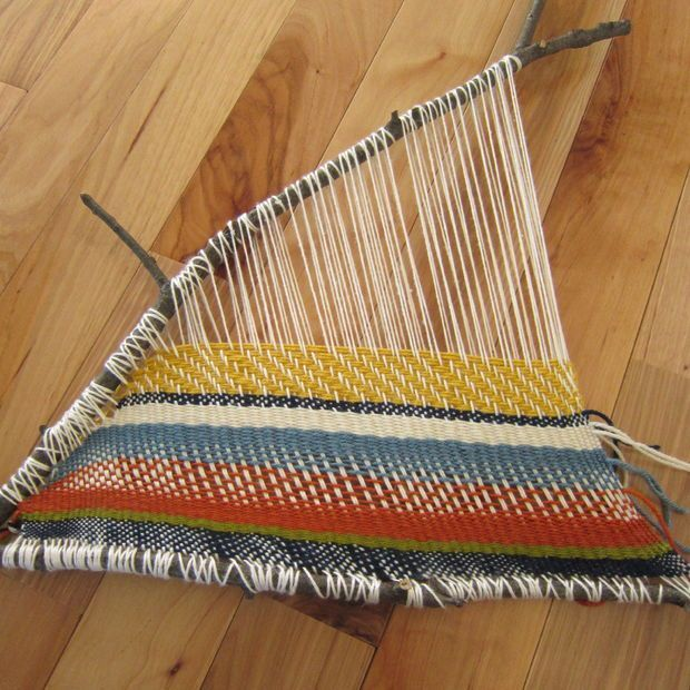 Branch weaving - fun nature activity for crafty and creative kids that just uses yarn