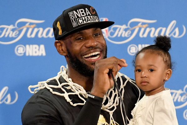 LeBron James Photos - LeBron James #23 of the Cleveland Cavaliers holds his daughter Zhuri during a press conference after defeating the Golden State Warriors 93-89 in Game 7 to win the 2016 NBA Finals at ORACLE Arena on June 19, 2016 in Oakland, California. NOTE TO USER: User expressly acknowledges and agrees that, by downloading and or using this photograph, User is consenting to the terms and conditions of the Getty Images License Agreement. - 2016 NBA Finals - Game Seven
