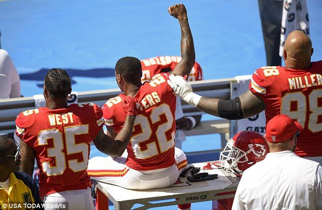 Kansas City Chiefs defensive back Marcus Peters (22) protests next to running back Charcandrick West (35) and defensive tackle Roy Miller (98) during the National Anthem prior to the game against the Los Angeles Chargers at StubHub Center