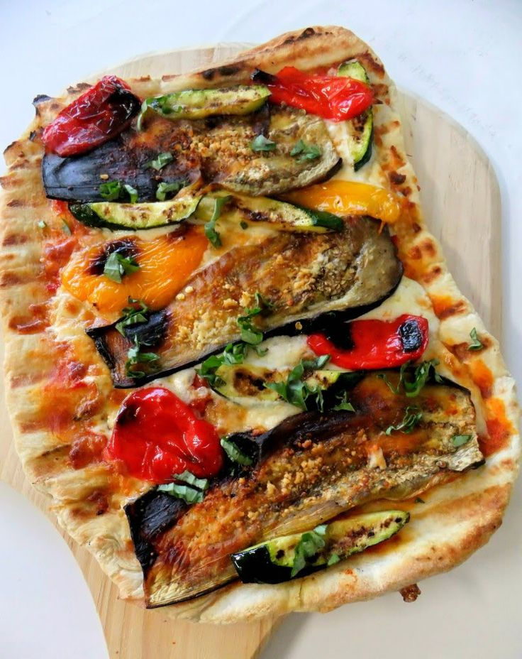Grilled pizza with eggplant, zucchini, red and yellow peppers with ...