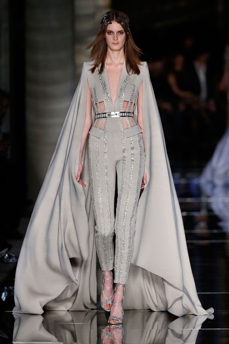 Couture Spring/Summer 2016 Tailored jumpsuit in greige featuring a notched collar jacket and long cape from the shoulders