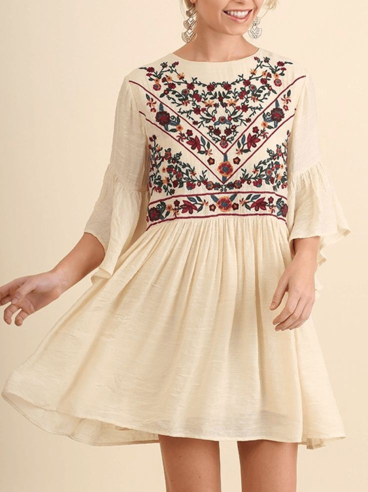 Gorgeous embroidery design across the chest in red, maroon, blue, green, and golden yellow. This cream dress is made of soft and flexible fabric that moves with you and falls wonderfully.Scoop neckline with a keyhole closure in back The hemline falls above your knee. Ruffled hi low bell sleeves finishes off this amazing dress. This boho babe swing dress is a casual dress that is perfect for your next party dress, weekend dress, vacation dress.   #bohodress www.ledyzfashions.com