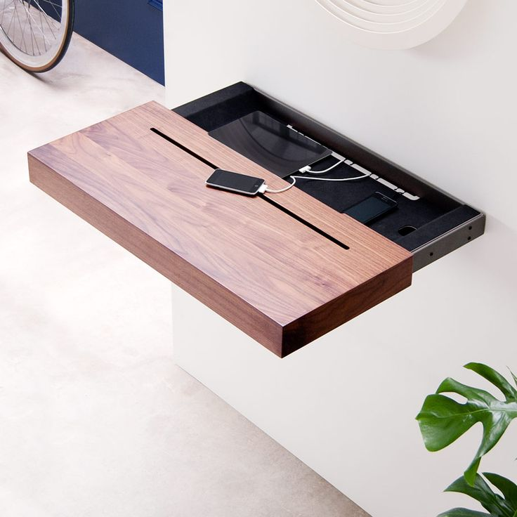 Shelves to Show Off Your Tech by Spell | MONOQI #bestofdesign | Origin Netherlands | Material Shelf: Walnut Wood Veneer. Lower Compartment: Foam Rubber, Powder-Coated Steel.