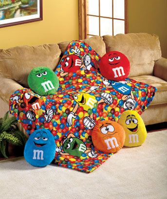 You can never go wrong with M&Ms. Plush M&M characters and snuggle blanket