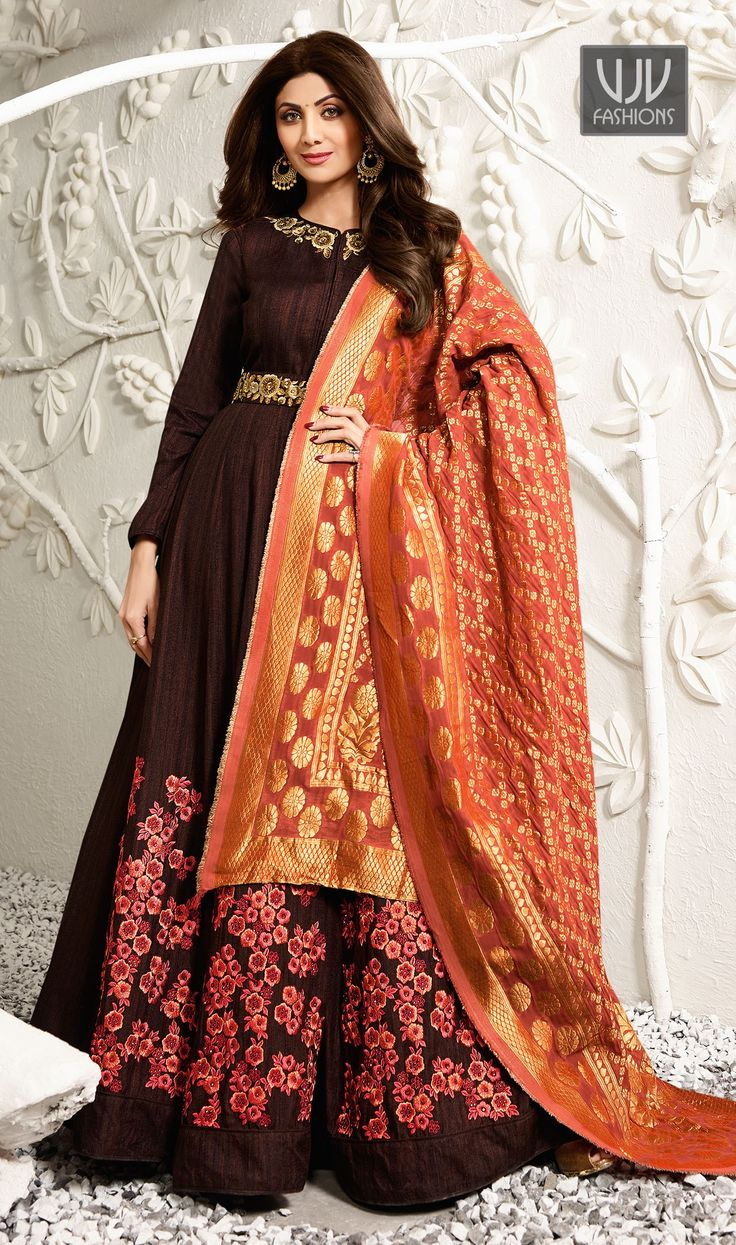 Shilpa Shetty Brown Color Raw Silk Designer Anarkali Suit  Be your distinct style diva with this Shilpa Shetty brown color raw silk designer anarkali salwar suit. The gorgeous embroidered and resham work through the attire is awe inspiring.