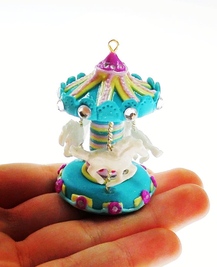 Miniature carousel from modeling clay by Alice's idea... Www.alicesidea.pl.  #polymerclay#craft#art#carousel#hourse#blue#jewelery#miniature#idea#pretty#cute#beatiful#fashion .