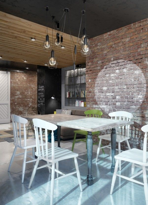 A neutral color palette with a few splashes of brightness is nothing too off the wall but bring a nice warmth to the brick and wood design. Mismatched dining chairs and caged lightbulbs are the finishing touches on this quirky style.
