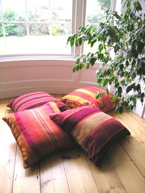 Moroccan shades of red and orange striped silk floor cushion