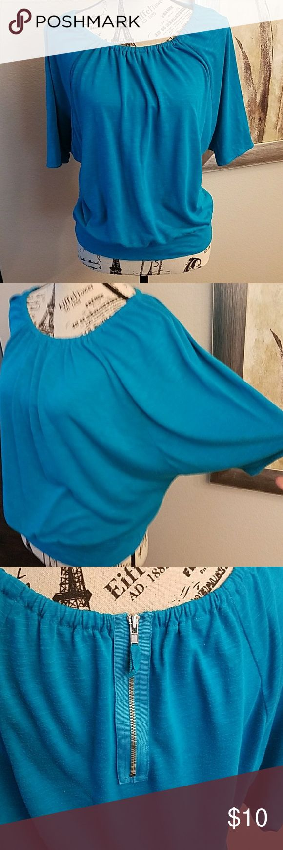 Ann Taylor LOFT top Oh how i love the zipper detail on the back!!! This top is in great condition and sort of teal color (4th photo is closest) and if you have brown eyes, they will definitely pop with this color! LOFT Tops