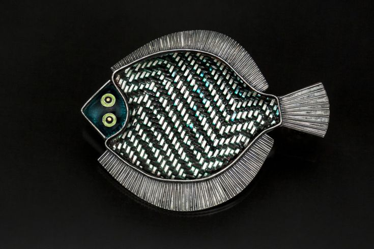Jeanie Pratt | Flat Fish Materials: Argentium silver, fine silver, copper, 22K gold, enamel Dimensions: 2.35 x 3 x .15 Inches Techniques: Handwoven, enameled, fabricated, oxidized Photographer: Carol Holaday