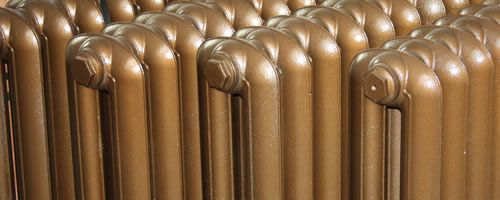 cast iron radiators painted in Old Penny