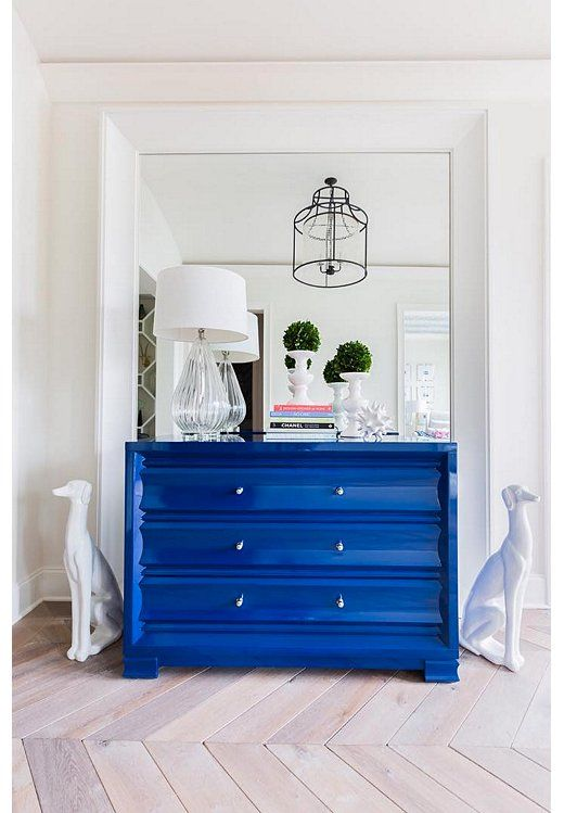Bring some bold color to your entryway with a chest of drawers painted a vibrant and timeless shade of Yves Klein Blue.