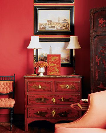 "My Asian side comes out in this room ... love it!  ""A Chinese-style red painted bureau has a faux-marble top. Black tole candlestick lamps, a set of lacquered stacking boxes, and a grouping of 18th-century English prints depicting Asian-inspired scenes continue the chinoiserie theme."" @ marthastewart.com"