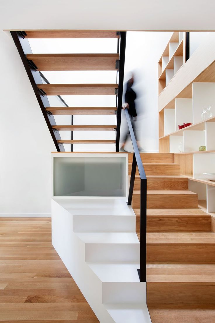 Chambord Residence is a minimalist house located in Montréal, Canada, designed by Naturehumaine. The client wanted to utilize the second storey of her 1920s duplex by converting her former rental unit into 3 bedrooms and an office space. While the grey-stone front facade only required minor restorations, the back of the house was transformed completely. An emphasis on transparency creates constant visual and physical connections with the backyard. (10)