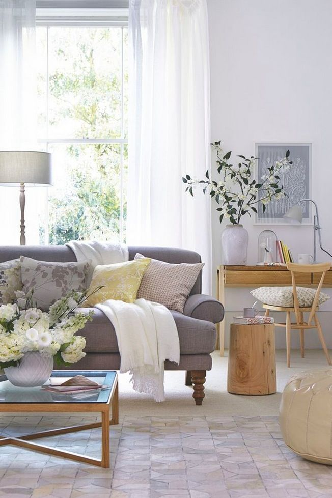 Stunning neutral living room scheme with a grey sofa and wooden accessories.