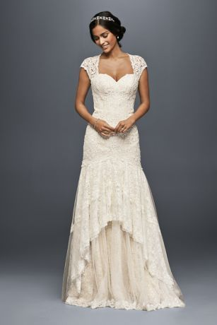 A sublimely romantic mermaid wedding dress, this feminine style features lace cap sleeves and an intricate bodice created from over 3,000 beads. The tiered skirt is a dreamy mix of lace and tulle.