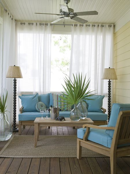 Teak furniture forms an appealing seating area in the breezeway . Curtains hung around the perimeter of the area billow in the gentle wind. (Photo: Antoine Bootz)