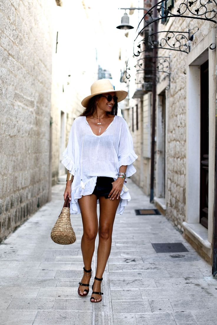 DISCOVERING TROGIR , CROATIA Croatia - Bartabac. White ruffle tunik+blak denim shorts+black ankle strap sandals+straw handbag+straw hat+sunglasses. Summer Travel Outfit 2016