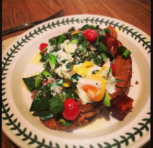 Spinach, egg, Choritzo, avocado on toast with tomatos, spring onions, natural yogurt + seeds