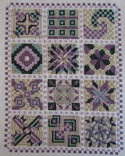 Cross stitched quilt blocks.