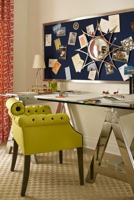 Check out that mirror above the desk.  What a great solution if you must have your back to the door in an office space!
