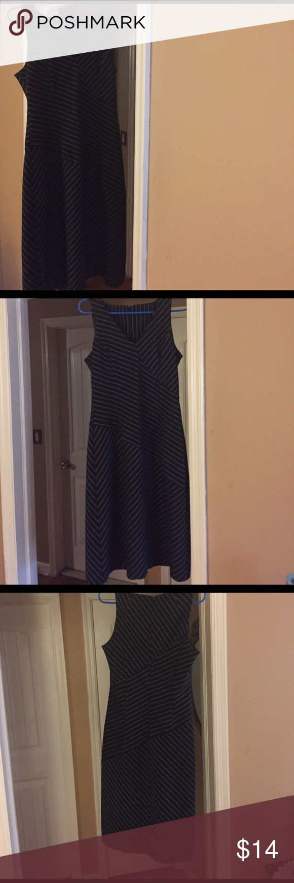 """Striped black and white dress. Striped sheath dress, back zipper, form fitting. I removed the back ticket since it felt scratchy. Back  zipper goes down to waist. Dress has elastic. Thick fabric, Good quality. Purchased at Bloomingdales. Barely worn in excellent condition,no longer fits. Measurements are: flat/relaxed Chest 15 1/2"""", stretched 17"""" (31""""-34""""), Waist 15"""" -16"""" (30-32) length 41"""" taken from the shoulder to bottom. Bottom opening 24"""". Person in the picture is 5 3"""" 125 lbs wears a…"""