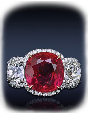 A Magnificent Ruby & Diamond Ring, Composed Gubelin Certified 10.20 Ct. Cushion Cut Pink Red Ruby, Flanked By 2 Cushion Cut Diamonds Framed By 4.40 Ct. Pave' Set White Diamonds, Mounted In Platinum And 18K White Gold. Jacob & Co.