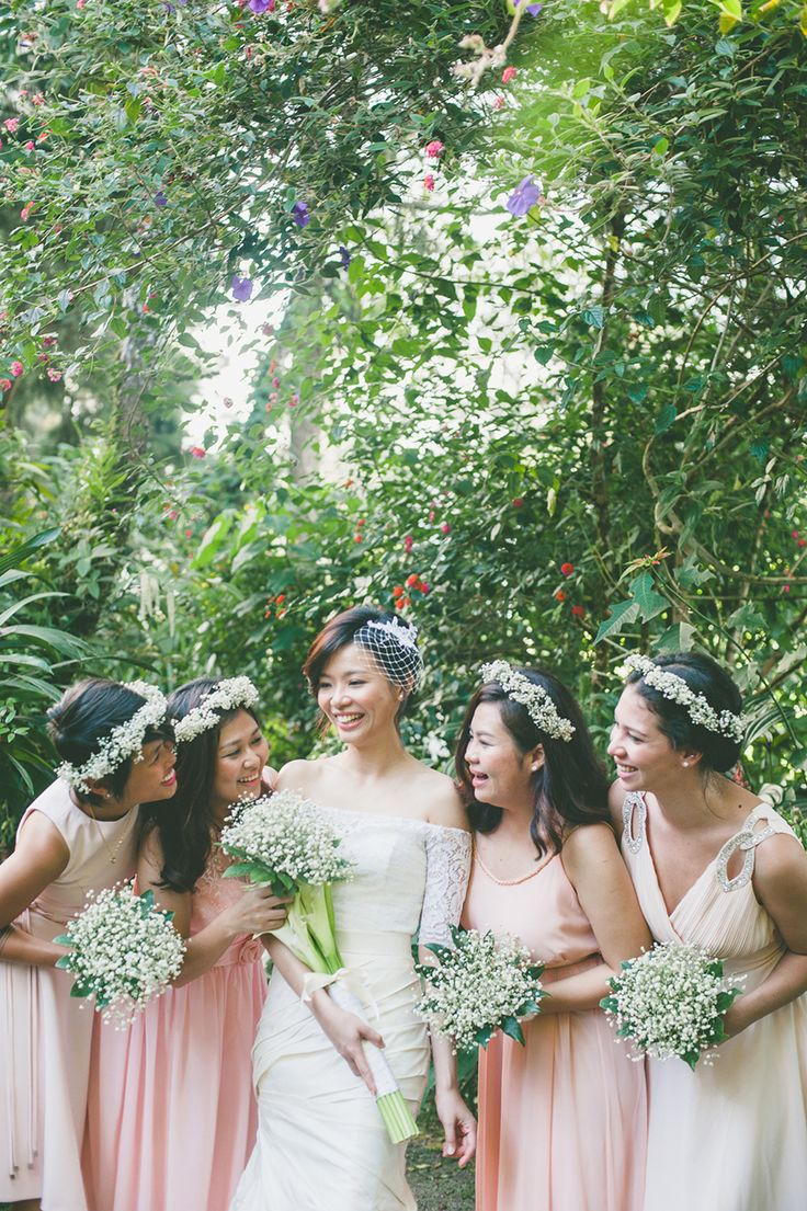 Bride and bridesmaids in white baby's breath floral crowns and bouquets wearing white wedding gown and blush pink bridesmaids dresses // Mun Chung and Emily's wedding took place only a day after their pre-wedding shoot in Cameron Highland's idyllic tea plantations. Held at The Smokehouse Hotel & Restaurant, their celebration complemented venue's colonial architecture with simple DIY floral arrangements and guests decked out in lounge suits and their finest fascinators.