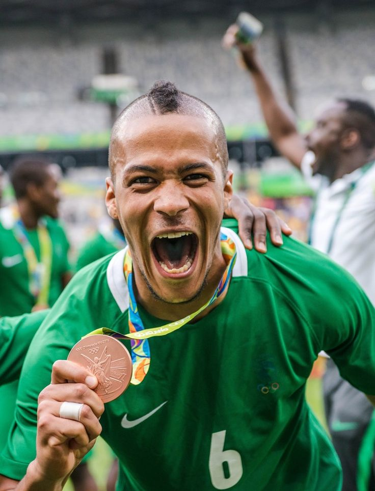 Nigeria's William Ekong displays his bronze medal during the medal ceremony after defeating Honduras in the Rio 2016 Olympic Games men's bronze medal football match at the Mineirao stadium in Belo Horizonte, Brazil, on August 20, 2016.  / AFP / GUSTAVO ANDRADE
