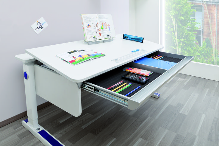 The Champion desk by Moll. Adjustable height for ages 5 and into the teens. Adjust the desk height via the round yo-yo on the side utilising a seamless and safe rope pull.  Tilting desk-top up to 16 degrees, with easy adjustment by rope pulleys at the front desk edge. Comes in full desk top tilt or sections ( right or left side up ). Comes with 8 trendy colour inlays. Exchangeable side panels in 12 colour versions.  Book holder with page clip; foldable and mobile.