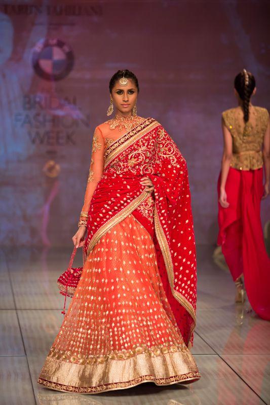 Tarun Tahiliani red sari lehnga bridal. More here: http://www.indianweddingsite.com/bmw-india-bridal-fashion-week-ibfw-2014-tarun-tahiliani-show/