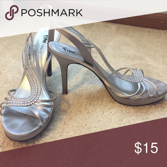 Silver heels size 10 Silver heels, size 10, homecoming/prom shoes, only worn twice FIONI Clothing Shoes Heels
