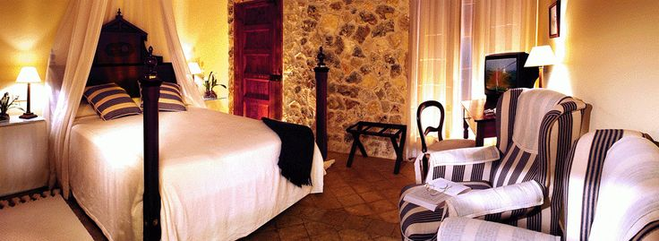 Traditional Majorcan bedroom, with classic and bold furniture and artisanal textiles.