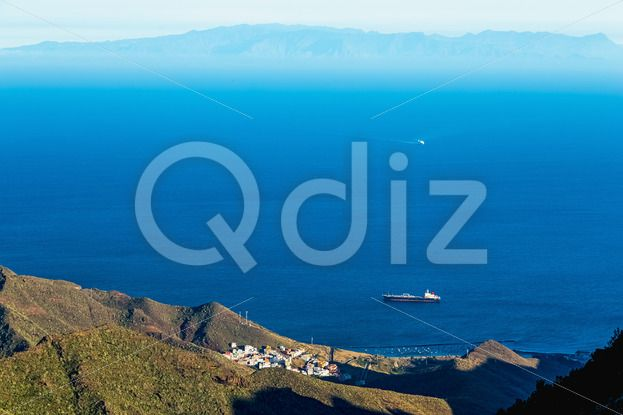 Qdiz Stock Photos | View from above on ocean and island on background,  #aerial #background #blue #boat #cargo #commerce #commercial #container #delivery #empty #fog #freight #haze #horizon #industrial #industry #island #logistics #marine #mountain #moving #nautical #ocean #rock #sea #seascape #shadow #ship #shipping #sky #tanker #transport #transportation #vessel #view #water #waterline