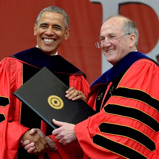 U.S. President Barack Obama accepts an honorary degree from Rutgers President Robert Barchi at High Point Solutions Stadium during Rutgers University's 250th commencement. The president also gave a keynote speech to a cheering crowd, a commencement the university had been seeking for 3 years. (Credit: Reuters/Mike Theiler)
