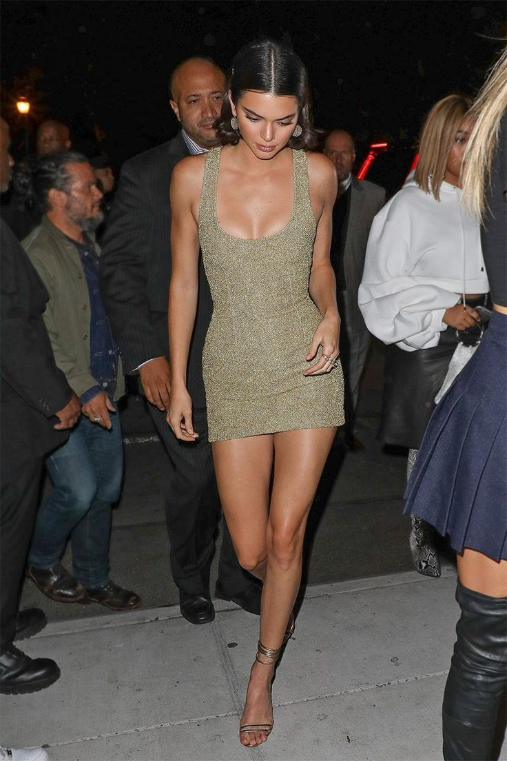 Kendall Jenner in a gold mini dress during #NYFW