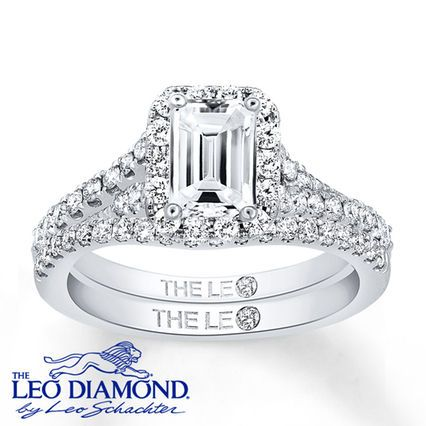 This Leo Diamond bridal set is a shining expression of your love. An awe-inspirng emerald-cut Leo Diamond is the highlight of the stunning engagement ring. Round diamonds sparkle along the 14K white gold band of the engagement ring and matching wedding band. The set has a total diamond weight of 1 1/5 carats. The center diamond is independently certified and laser-inscribed with a unique Gemscribe® serial number. Diamond Total Carat Weight may range from 1.18 - 1.22 carats.