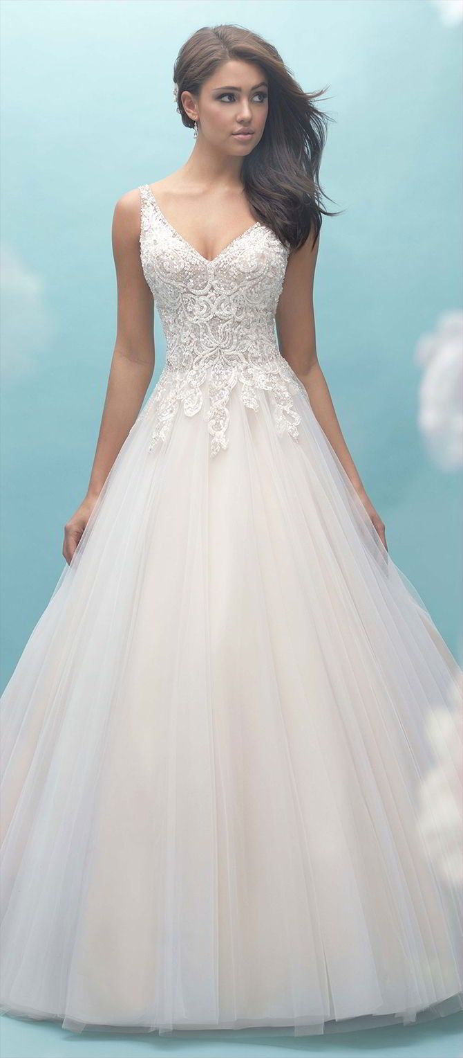 This multilayered tulle ballgown is a dream come true, with draped strings of beading across the open back.