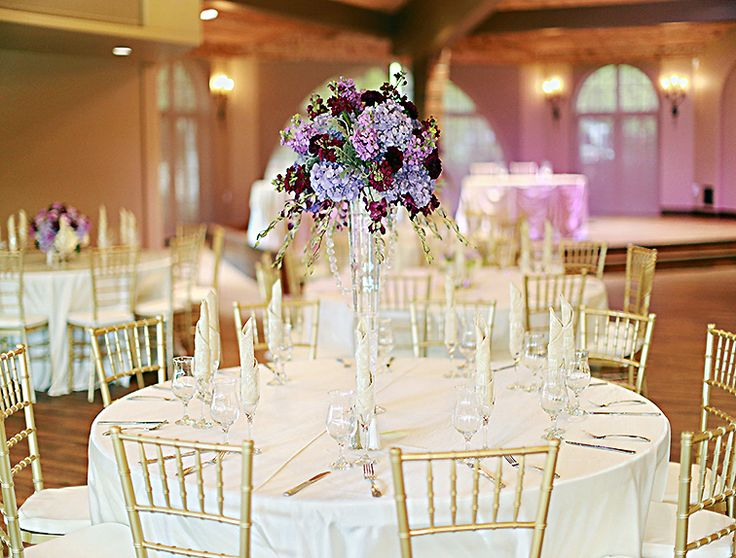 116 best four seasons wedding centerpieces images on pinterest san diego wedding flowers tall vase centerpiece with jewels made from dyed purple hydrangeas junglespirit Image collections