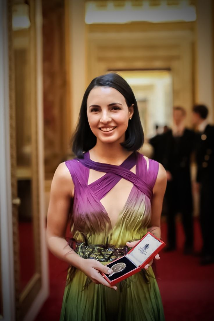 Queen's Young Leaders recipient 2017, Chantelle de Abreu in her custom hand dyed jumpsuit at Buckingham Palace