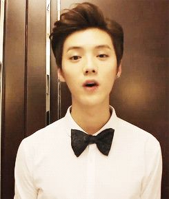 His shoulders are so adorable. Love his bowtie. His hair. His tiny smile. Luhan.