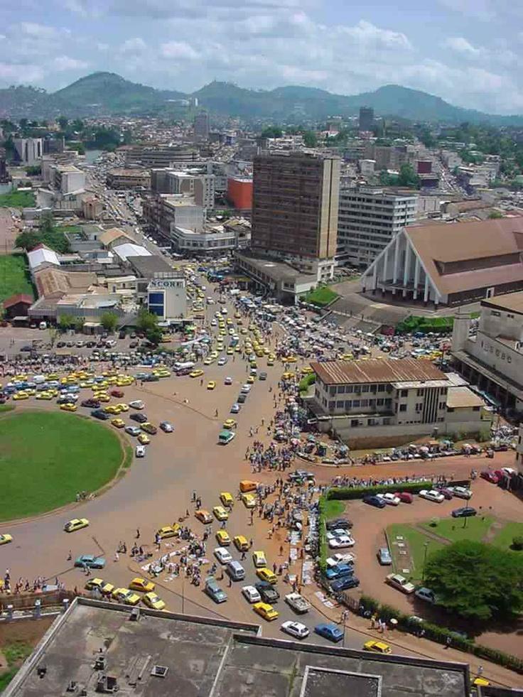 Yaoundé, Cameroon. Many, many cars, vendors and people line the streets.